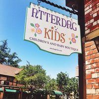 Atterdag Kids logo