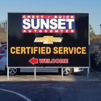 Sunset Auto Center logo
